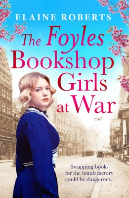 The cover of The Foyles Bookshop Girls at War. The title is written in pink and there is a young woman on the front with blonde hair and a blue period dress.